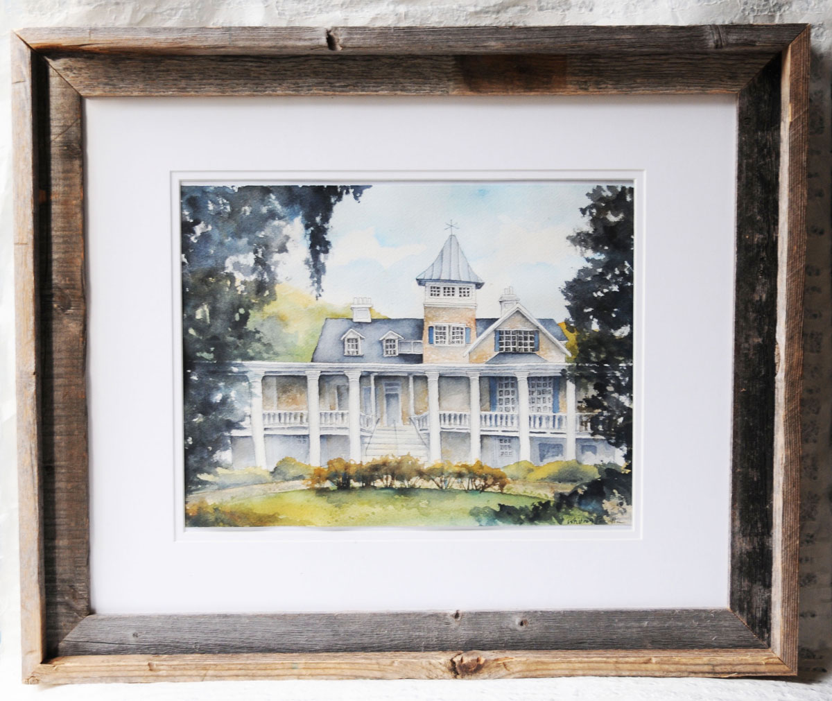A framed watercolor painting of Magnolia Plantation in Charleston, SC.